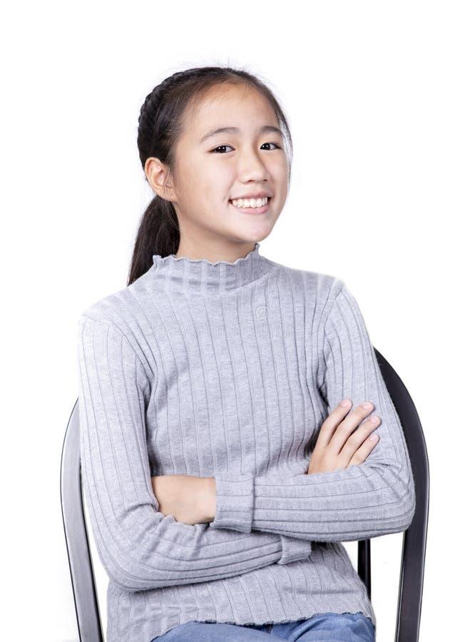 Fundo branco isolado de sorriso Toothy da cara adolescente asiático imagens de stock royalty free