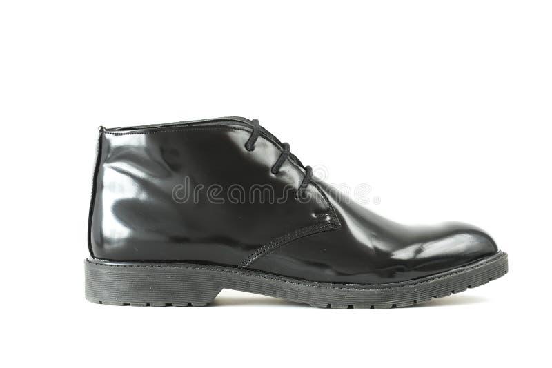 Fundo branco isolado do homem do couro envernizado bota preta foto de stock royalty free