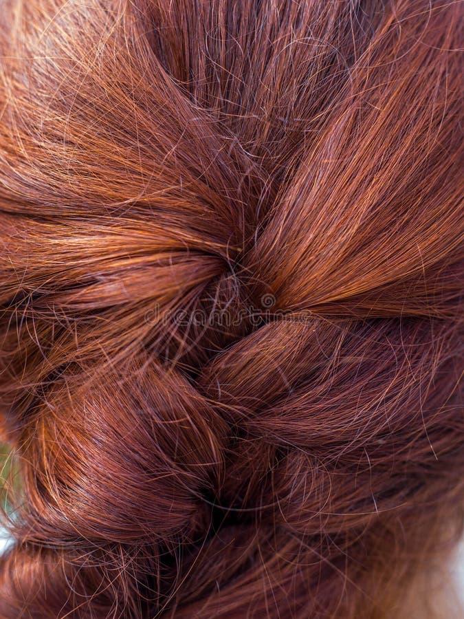 Fundo brilhante do cabelo fêmea humano vermelho A textura do cabelo humano hairstyles imagens de stock royalty free