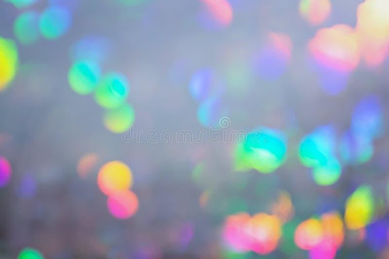 Fundo cinzento abstrato no borrão Luzes multicoloridos e pontos do defocus foto de stock royalty free
