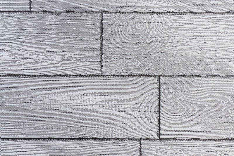 Fundo cinzento do papel de parede sob a forma das placas de imitação da madeira clara imagem de stock royalty free
