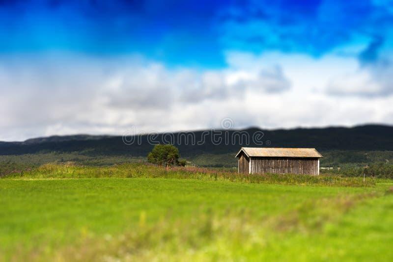 Fundo clássico do bokeh do celeiro de Noruega fotografia de stock