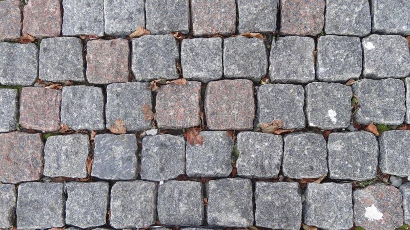 Fundo cobblestoned do pavimento do granito imagem de stock