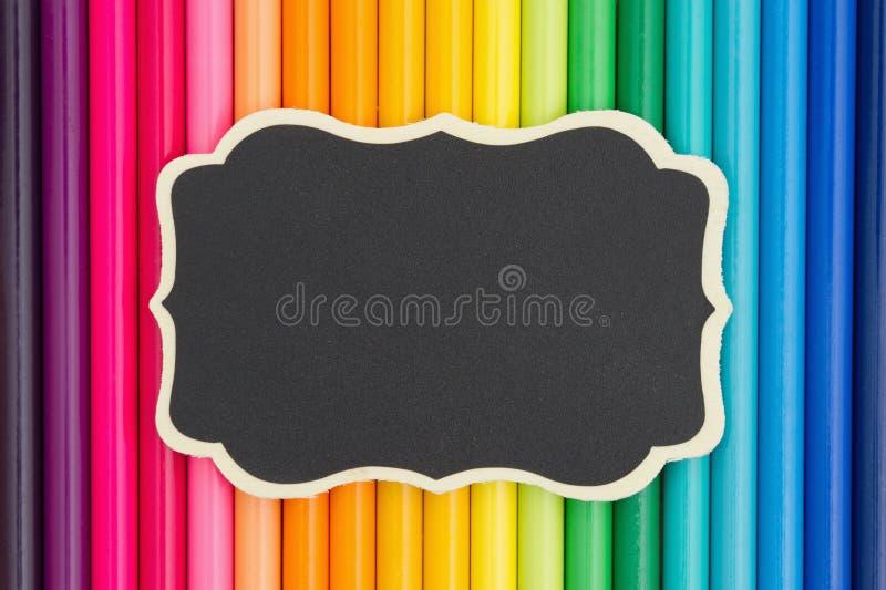 Fundo colorido da educação do pastel do lápis com um quadro foto de stock royalty free