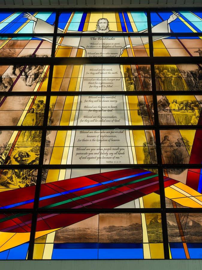 Fundo colorido da janela de jesus do šbright do ¼ do ï de SINGAPURA 8 DE ABRIL DE 2017 fotos de stock