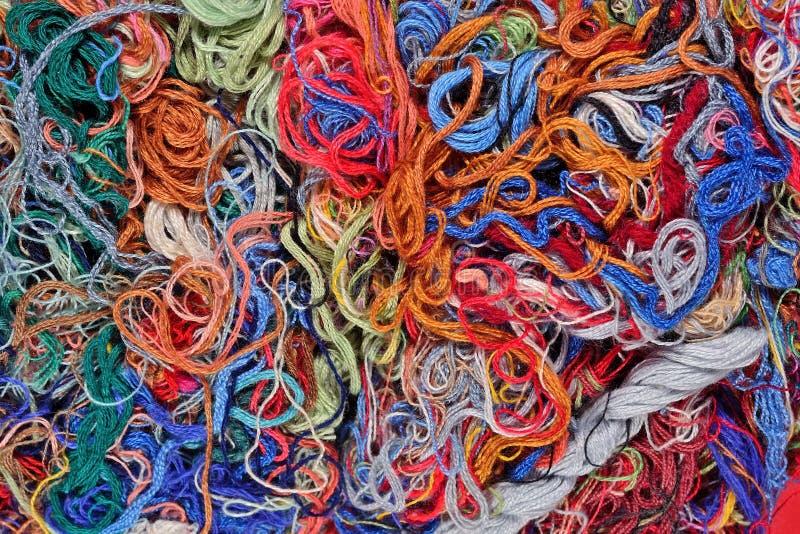Fundo colorido de floss do bordado imagem de stock