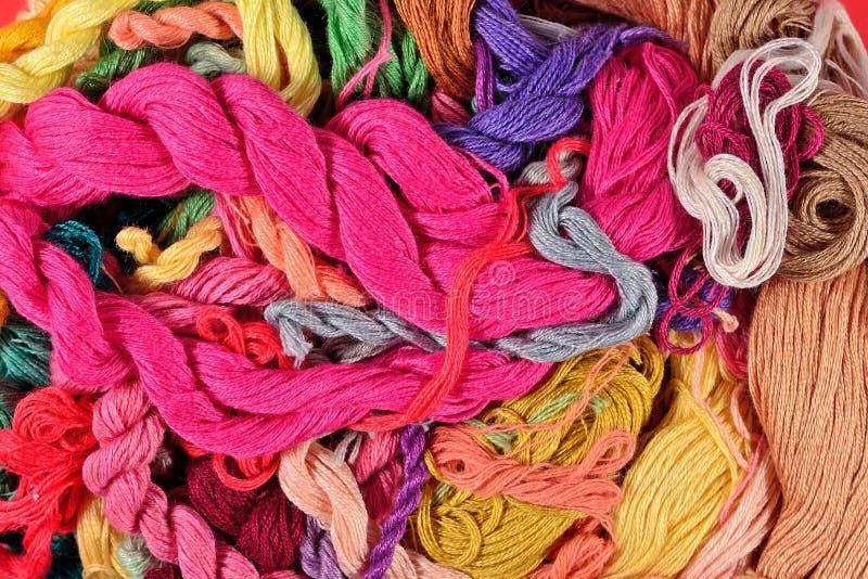 Fundo colorido de floss do bordado imagem de stock royalty free