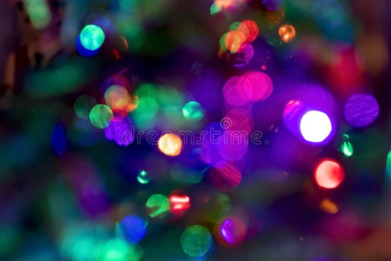 Fundo colorido do bokeh das luzes de Natal foto de stock