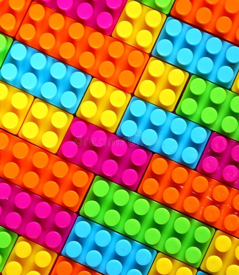 Fundo colorido do brinquedo do tijolo do lego das crianças imagens de stock