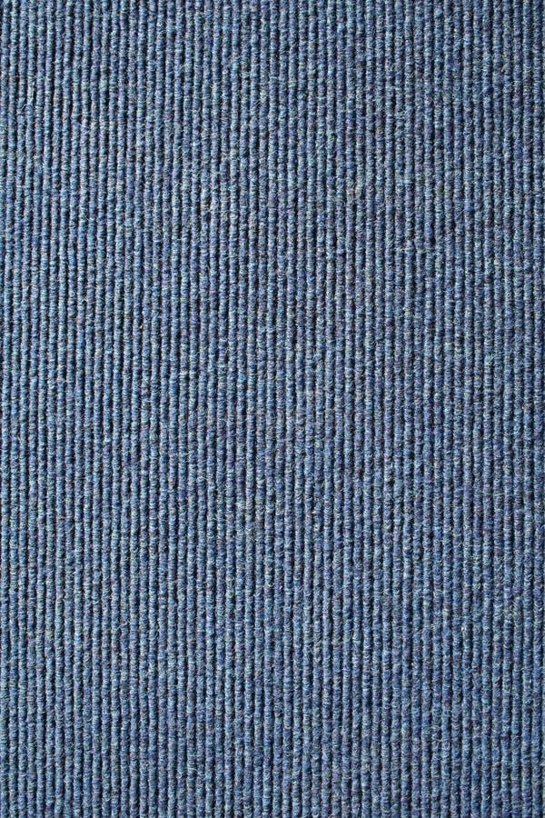 Fundo com nervuras azul do tapete. imagem de stock royalty free