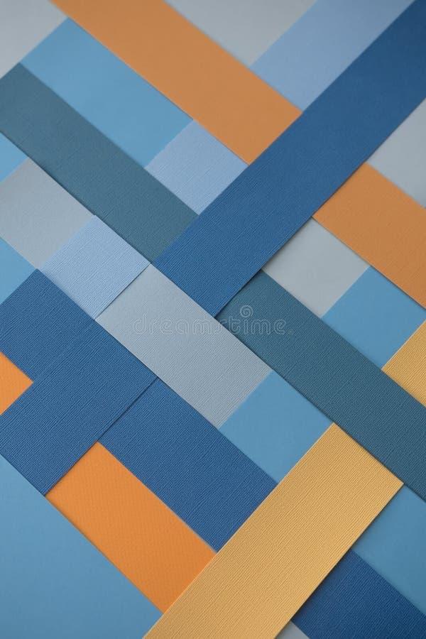 Fundo com testes padrões geométricos em cores azuis e amarelas imagens de stock royalty free