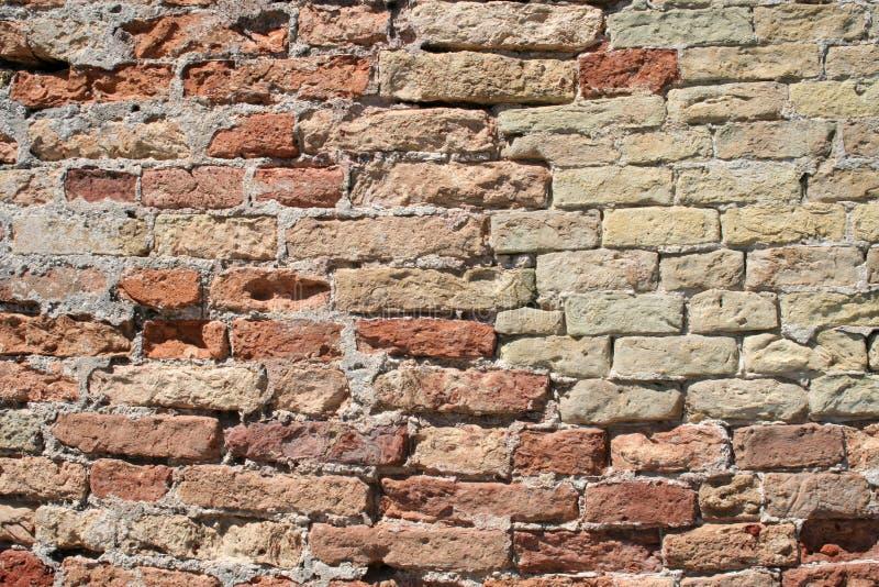 Fundo composto da parede de pedras imagens de stock royalty free