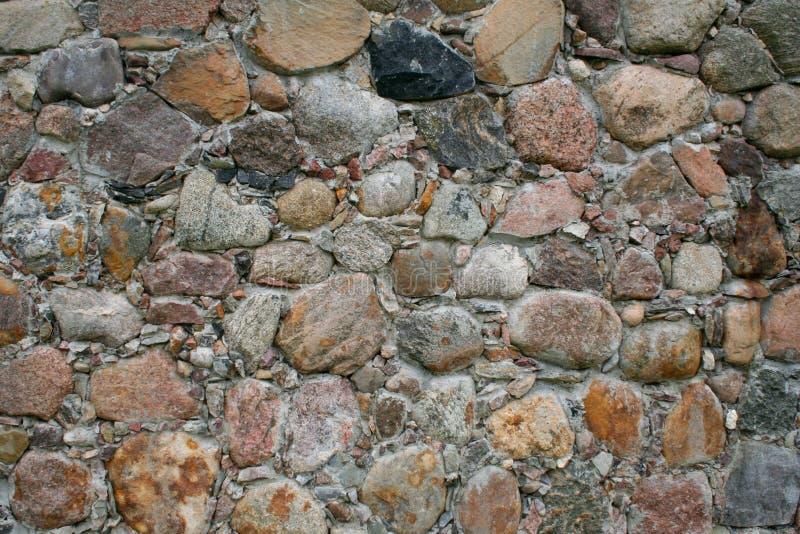 Fundo composto das pedras da parede imagem de stock
