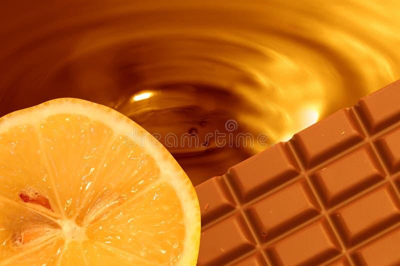 Fundo da laranja do chocolate fotografia de stock royalty free