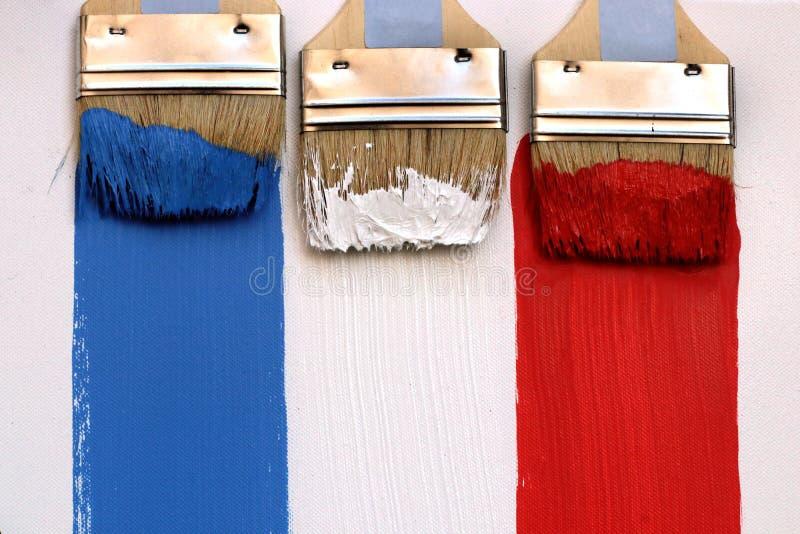 Fundo da lona dos pintores das escovas de pintura da bandeira de França imagens de stock royalty free