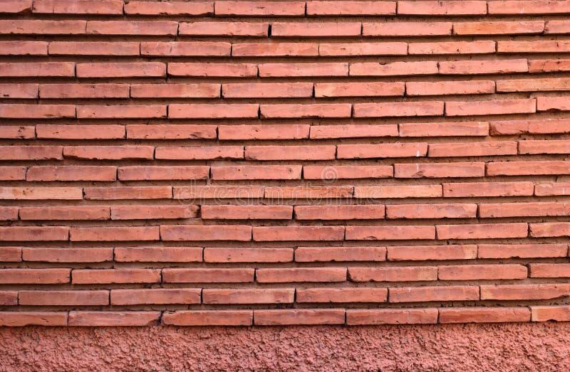 Fundo da parede de pedra da fachada de construção vermelha do contruction fotos de stock royalty free