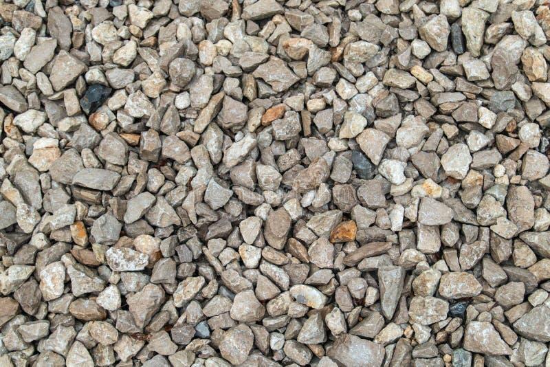 Fundo da textura do cascalho e de pedras claros fotografia de stock royalty free