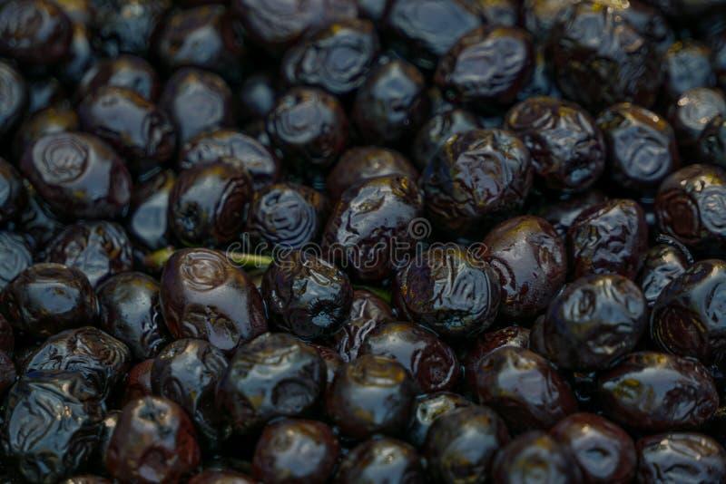 Fundo da textura do molde das azeitonas pretas imagem de stock