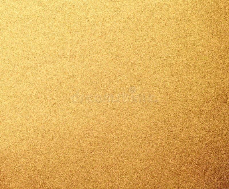 Fundo da textura do papel do metal do ouro fotos de stock royalty free