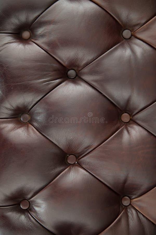 Fundo da textura do sofá do couro de Brown imagens de stock royalty free