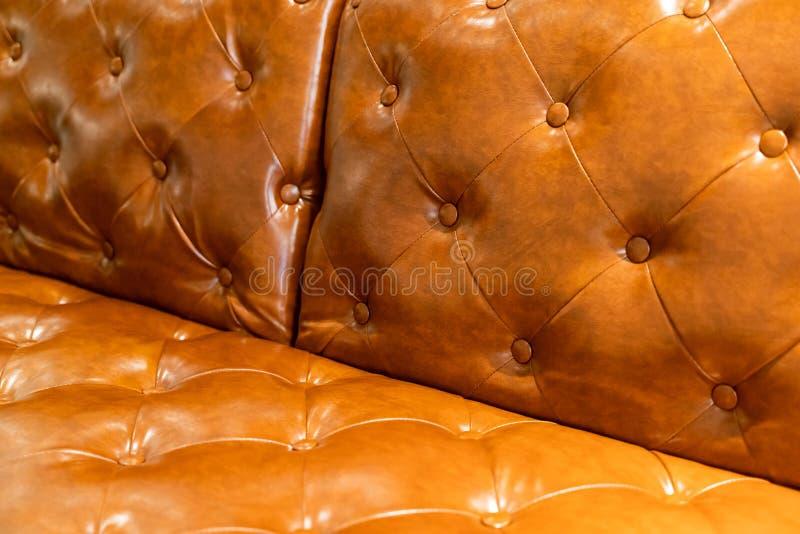 Fundo da textura do sofá do couro de Brown imagens de stock
