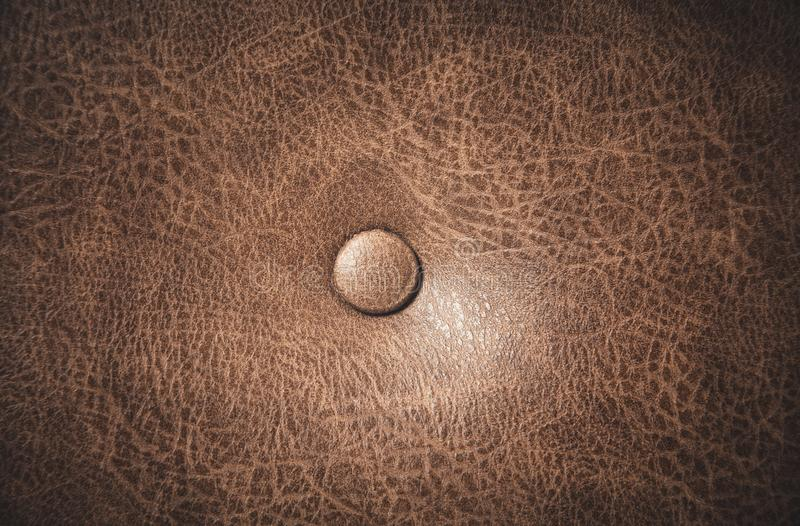 Fundo da textura do sofá do couro do marrom escuro fotos de stock