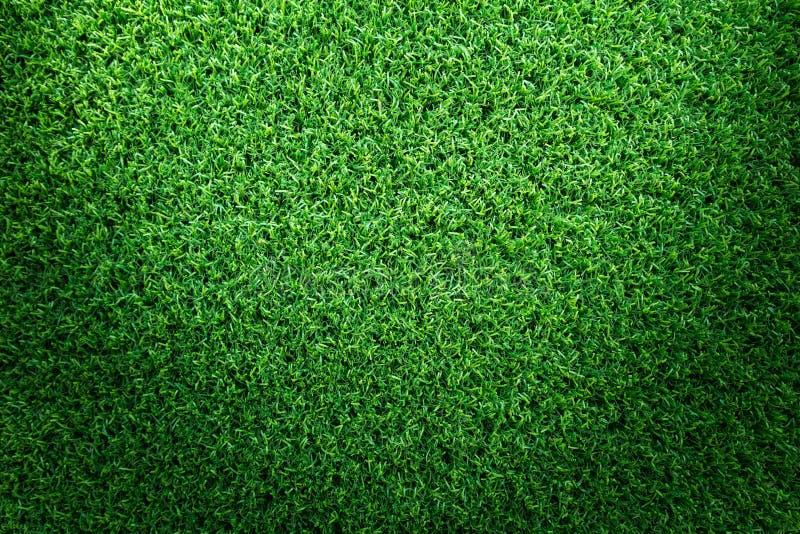 Fundo da textura da grama para o campo de golfe, o campo de futebol ou o projeto de conceito dos esportes Grama verde artificial imagem de stock