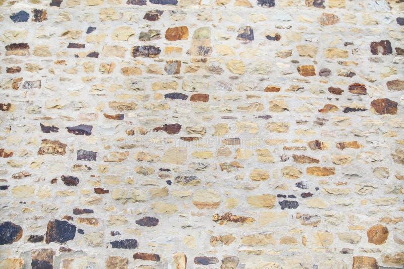 Fundo da textura da parede de pedra do tijolo da cor clara foto de stock royalty free