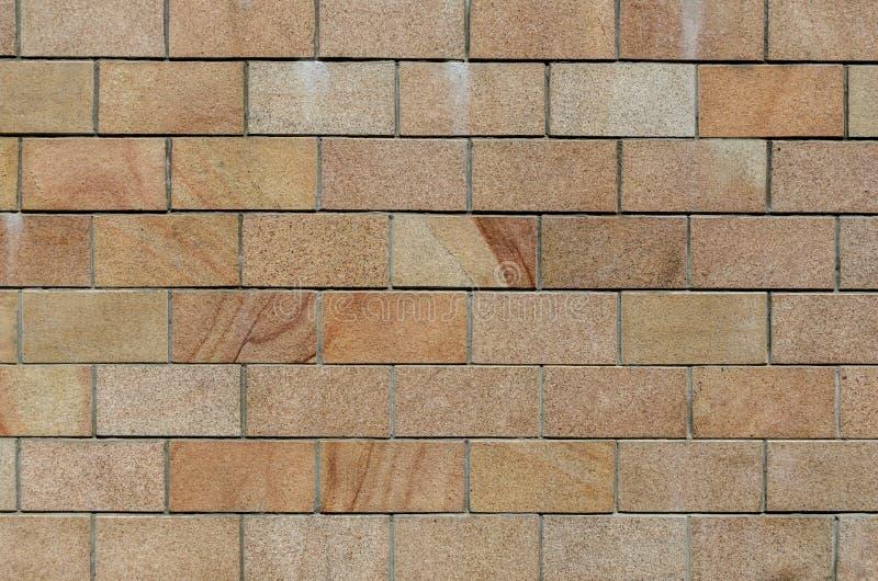 Fundo da textura da parede de tijolo Os tijolos velhos da grade do teste padrão da rocha interior do revestimento da alvenaria ou foto de stock royalty free