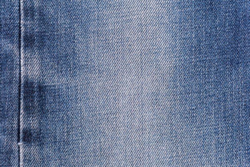 Fundo da textura da tela das calças de brim da sarja de Nimes com a emenda para a roupa, o projeto da forma e o conceito industri fotos de stock royalty free