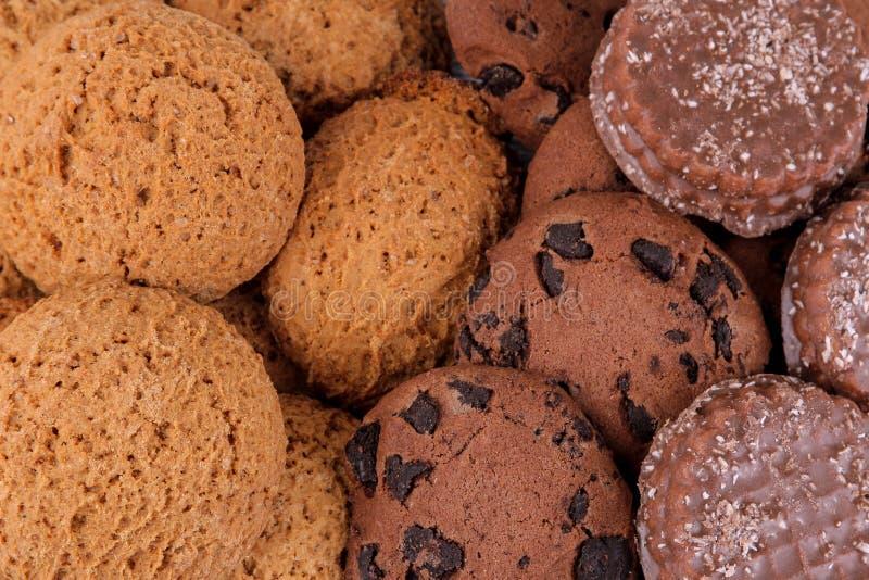 Fundo das cookies doces diferentes Cookies e chocolate de farinha de aveia fim da vista superior acima fotos de stock