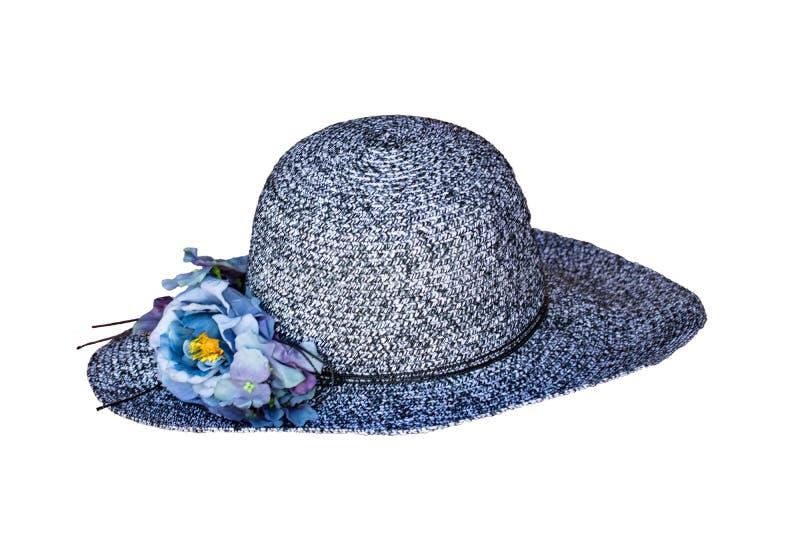 Fundo das decorações do chapéu de palha Close up de um chapéu moderno do sol da praia da palha da mulher azul isolado em um fundo imagem de stock