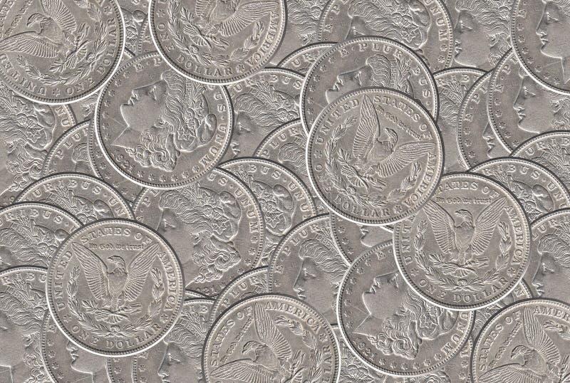 Fundo das moedas do dólar de prata fotos de stock royalty free