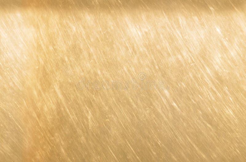 Fundo de bronze ou de cobre da textura do metal Claro riscado - textura de bronze marrom sem emenda imagem de stock royalty free