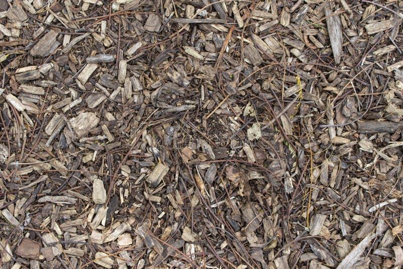 Fundo de Brown dos Woodchips da terra da textura exterior fotografia de stock royalty free
