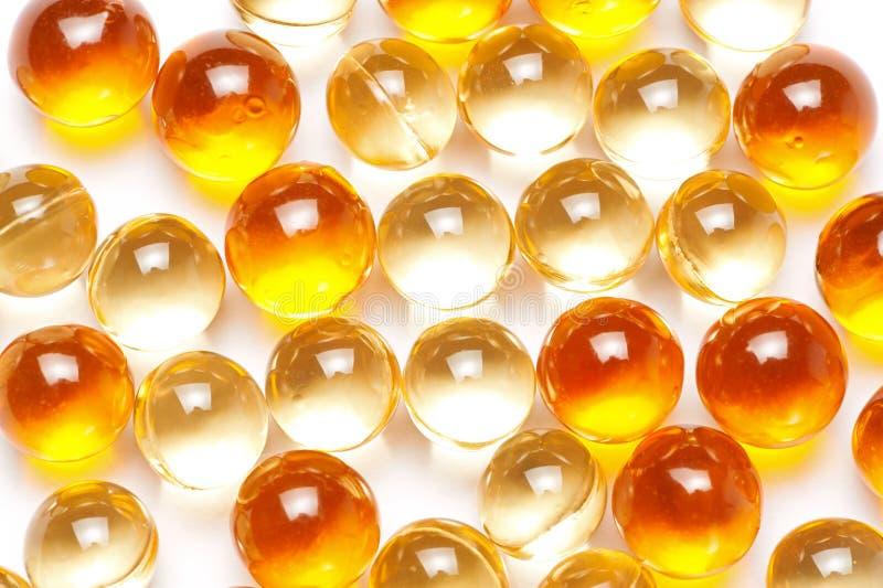 Fundo de cápsulas do óleo de peixes fotos de stock