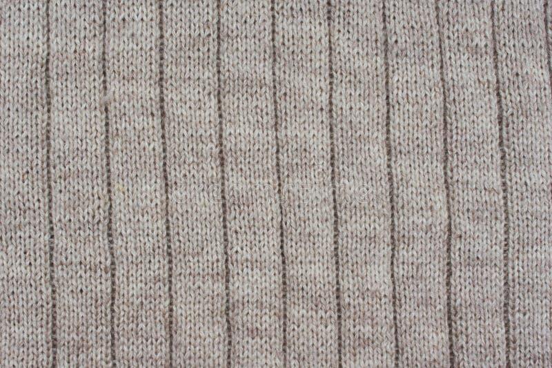 Fundo de cortinas textured bege Teste padrão feito malha fotografia de stock