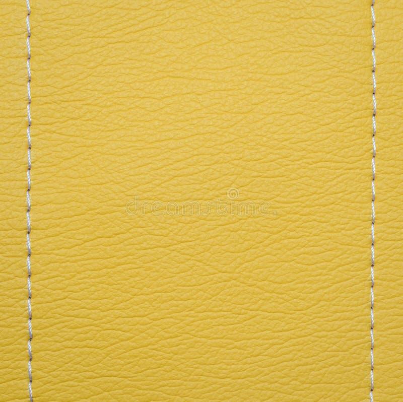 Fundo de couro amarelo da textura imagem de stock