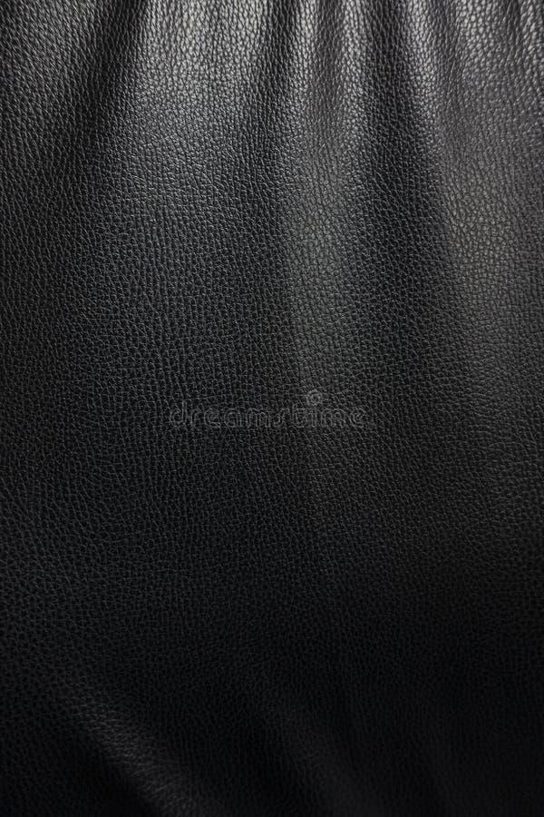 Fundo de couro preto da textura com destaque do downlight fotografia de stock royalty free