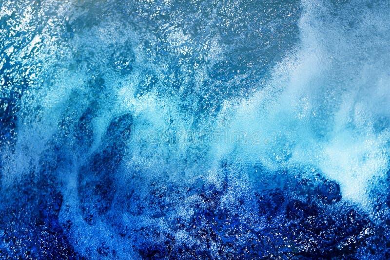 Fundo de Hoto da água de borbulhagem brilhante fotografia de stock