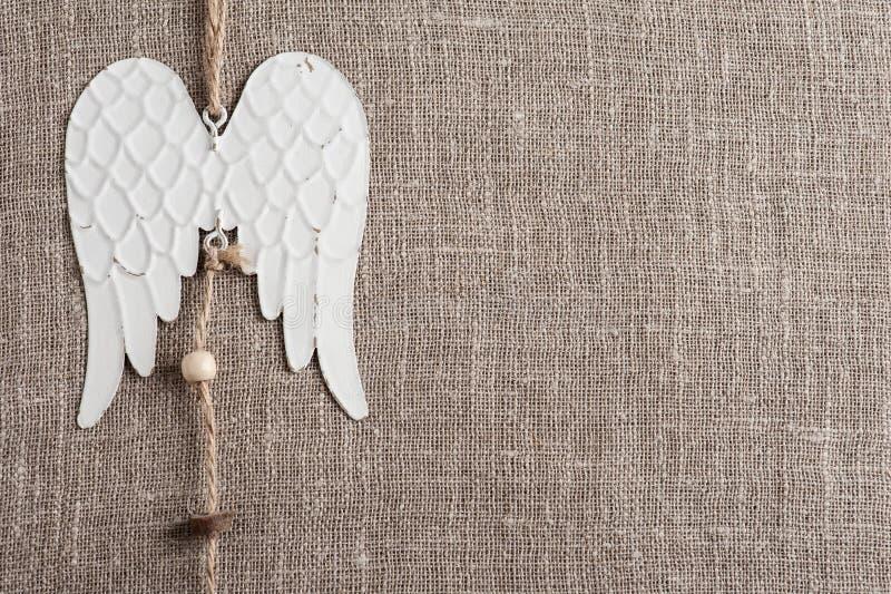 Fundo de linho com asas do anjo imagens de stock