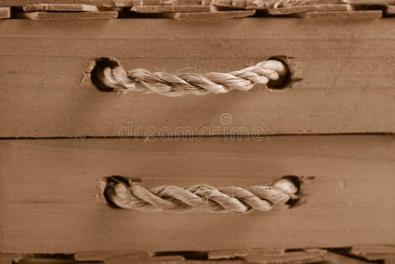 Fundo de madeira com punho da corda fotografia de stock royalty free