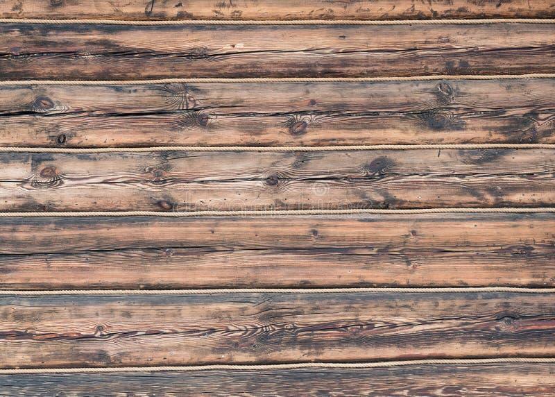 Fundo de madeira da textura da parede da corda dos logs fotos de stock