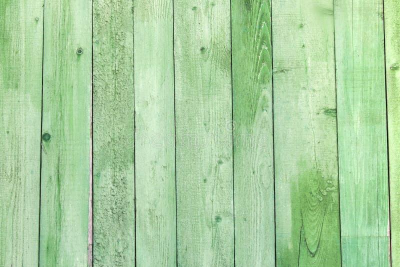Fundo de madeira resistido natural das pranchas Velho pintado no verde imagens de stock royalty free