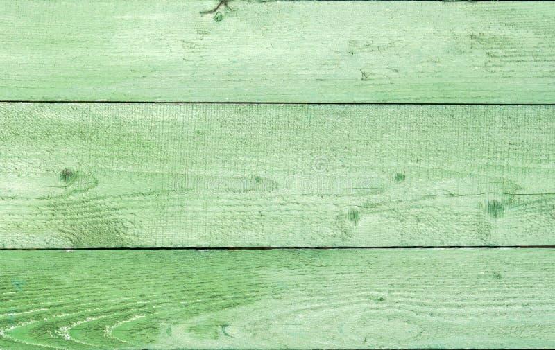 Fundo de madeira resistido natural das pranchas Velho pintado no verde imagem de stock royalty free