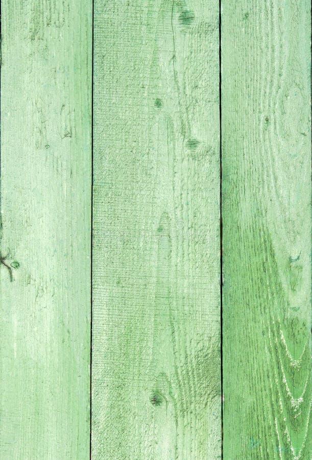 Fundo de madeira resistido natural das pranchas Velho pintado no verde imagens de stock