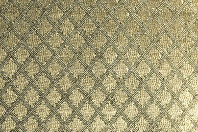 Fundo de matéria têxtil do ouro fotografia de stock royalty free