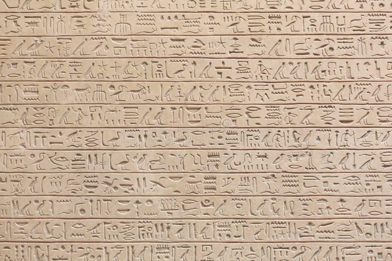 Fundo de pedra dos hieróglifos egípcios imagens de stock royalty free