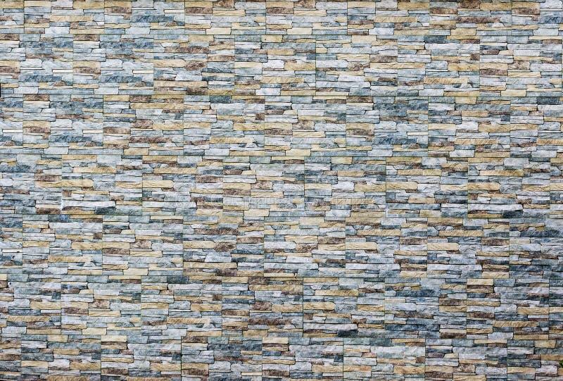 Fundo de pedra moderno da textura da parede de tijolo O teste padrão da parede de tijolo aplainou imagens de stock