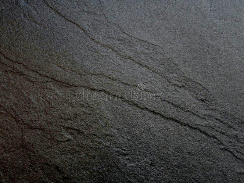 Fundo de pedra preto do teste padrão da ardósia fotos de stock royalty free